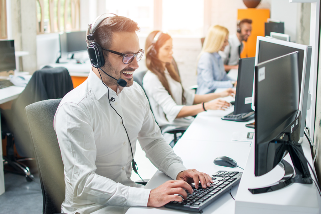 Young male technical support dispatcher in call center