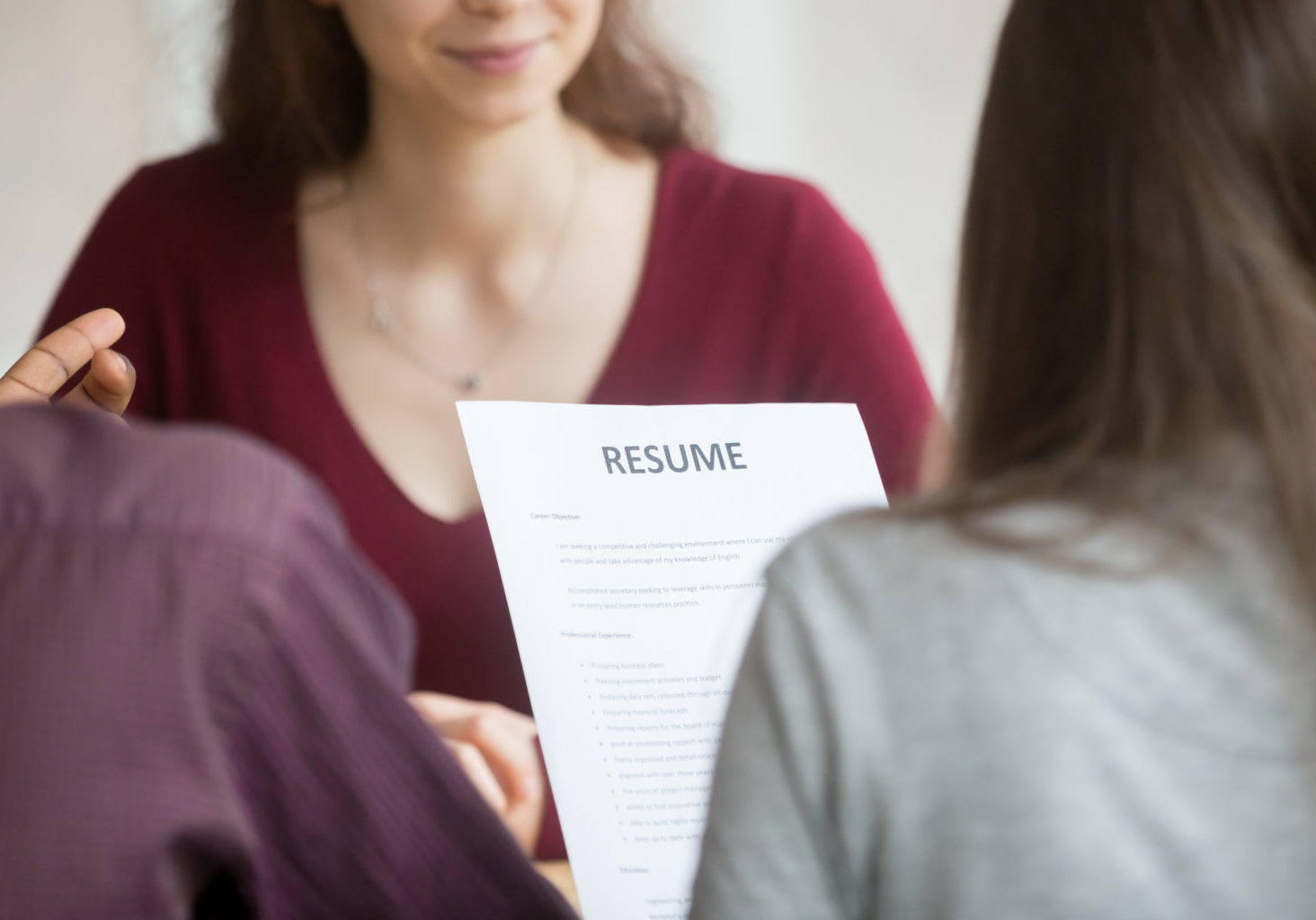 Multiracial,Hr,Holding,Resume,At,Job,Interview,With,Woman,Candidate,